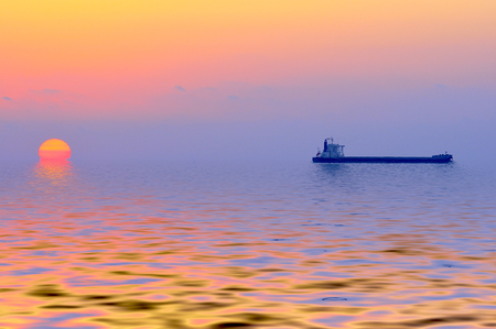 barge: sunset at  Mediterranean sea with barge