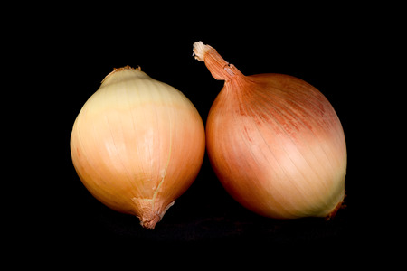 gold onion bulbs isolated on a black background