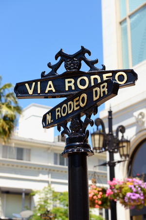 LOS ANGELES, CA - APRIL 4, 2017: Closeup of street sign for N.Rodeo Drive and Via Rodeo Drive in Beverly Hills, CA