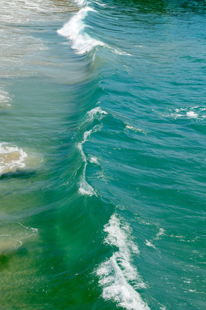 americal: Beautiful surf of green water of Pacific ocean. Stock Photo