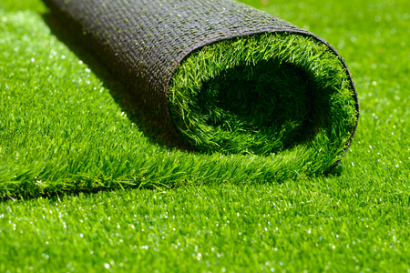 artificial rolled green grass; closeup Standard-Bild