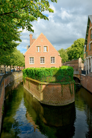Brick house on the canal in Amiens. France.