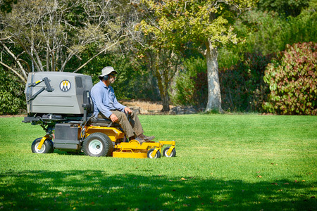HAIFA,ISRAEL- OCTOBER 22,2017: Man working on lawn mower in the public park.