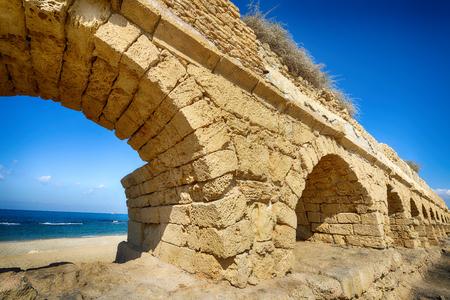 Ancient Roman aqueduct at Caesarea. Israel Stock Photo