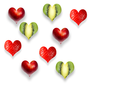 Fresh fruits in the shape of heart isolated on white