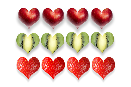 Fresh fruits in the shape of heart in row. Isolated on white. Stock Photo