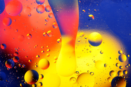 Abstract light background with lot of color spheres and spots.