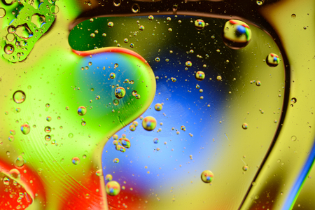 Abstract light background with lot of color spheres and bubbles.