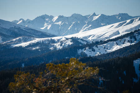 Beautiful scenic landscape with snow-capped mountains in the Caucasus ski area, Russia