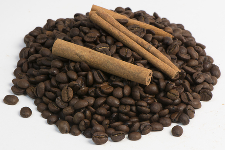 grains of black coffee and from above cinnamon stick Stock Photo