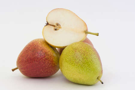 ripe four pears and one cut isolated on a white background photo
