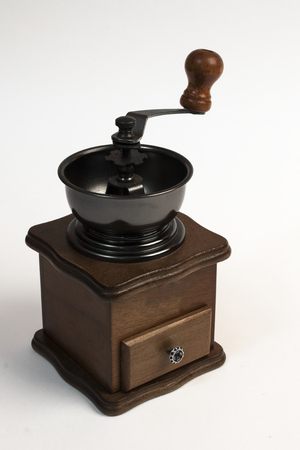 coffee grinder: one ancient coffee grinder on the white isolated background Stock Photo