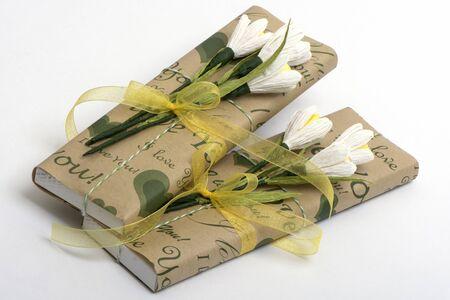 tulips isolated on white background: chocolate with tulips and tapes on the isolated white background Stock Photo