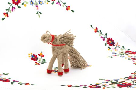 horse in tarditsionny style against the background of a color cloth Stock Photo