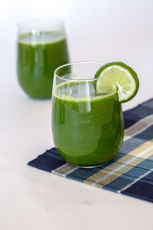 Green Juice with 2 glasses on Blue