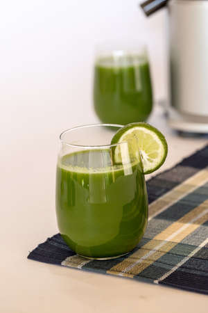 Green Juice with Juicer in background