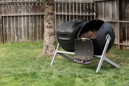 table scraps: Backyard composter Stock Photo