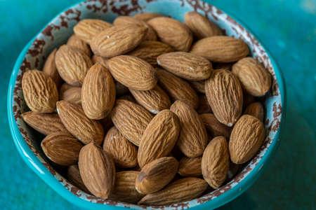 Almonds in Blue Bowl Stok Fotoğraf