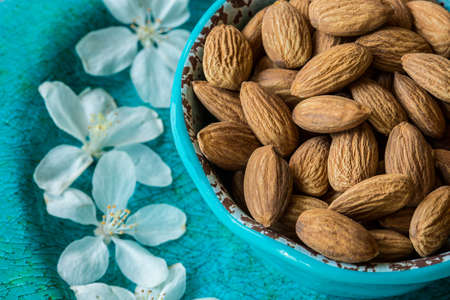 Almonds in Blue cup with white flowers