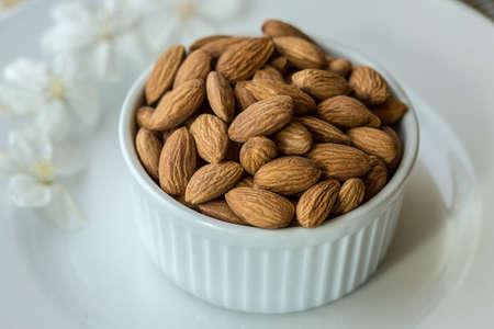 Almonds in white dish
