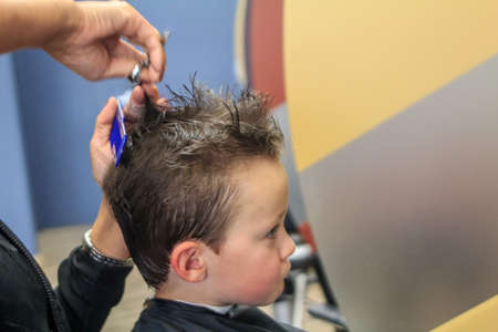 haircut: Cute Boy getting Haircut Stock Photo