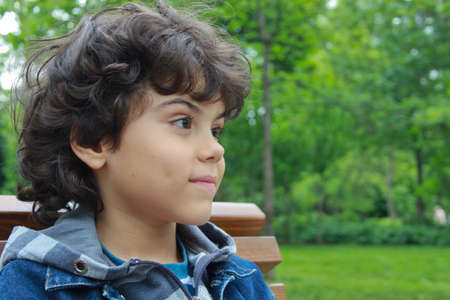 Beautiful boy in the park photo