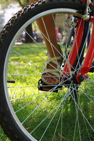 Close-up picture of a bicycle with a woman s foot, detail photo