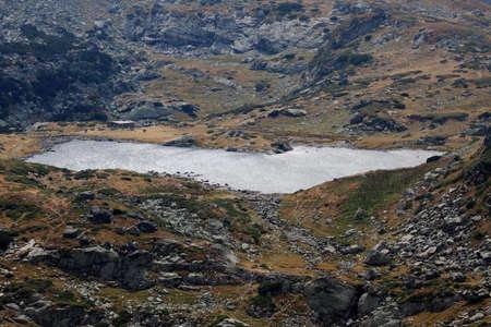Landscape with high mountain lake in Rila, Bulgaria photo