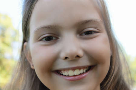 Close up portrait of a happy blond girl