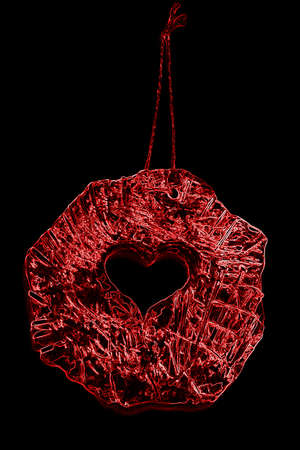 Abstract red heart on black background photo