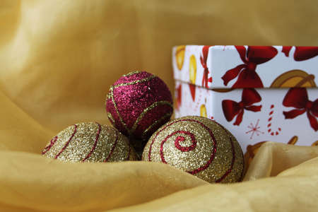 colrful: Handmade gift box with christmas balls, isolated on yellow cloth