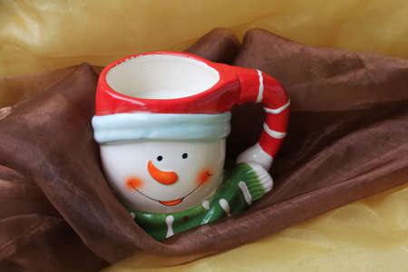 Christmas cup of a snowman with milk, isolated photo