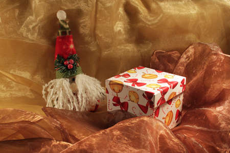 colrful: Handmade gift box and christmas toy isolated on two colors cloth Stock Photo