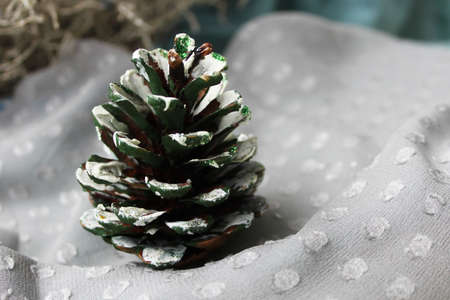 fir cone: Christmas picture with natural fir cone painted in white  Stock Photo