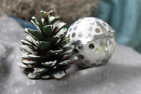 fir cone: Christmas picture with natural fir cone painted in white and silver ball
