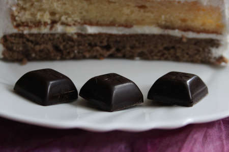 three layer: Chocolate candies and three - layer cake as background