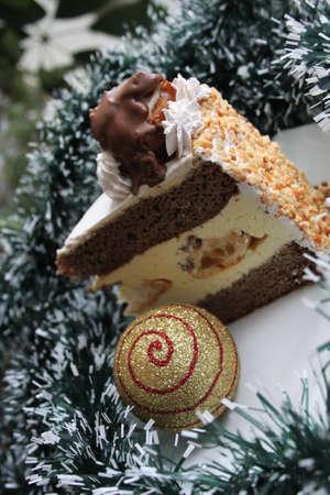 Christmas cake and festive ball on white - green garland Stock Photo - 16714655