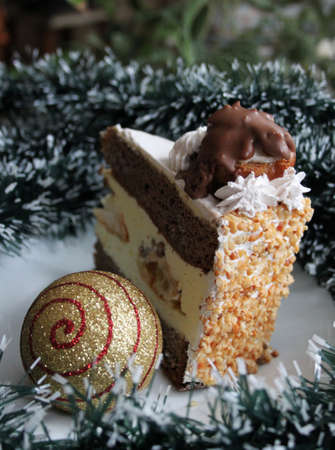 Christmas cake and festive ball on white - green garland Stock Photo - 16714651