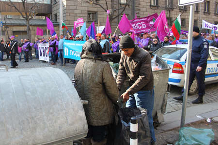 labor union: Tramps in foreground of labor union manifestation for work in Sofia, Bulgaria, 5. 03. 2013