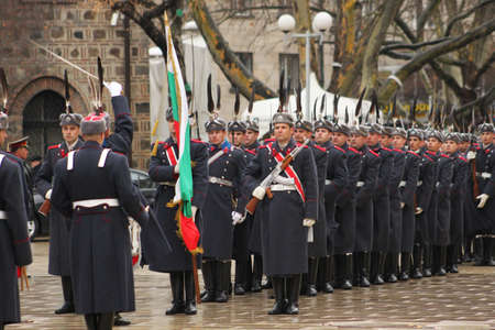 Parade of bulgarian guards with bulgarian flag Stock Photo - 18750154