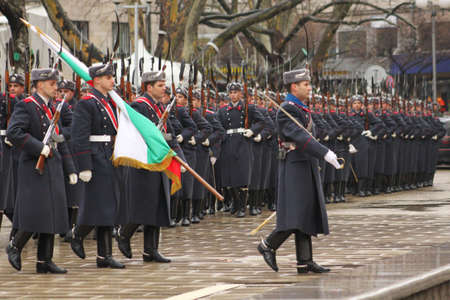 greatcoat: Parade of bulgarian guards with bulgarian flag