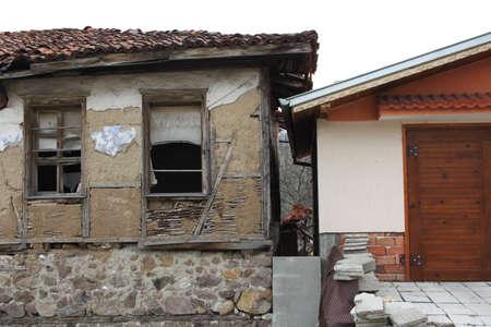 abandoned house: Opposites - old house near new house