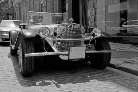 Closeup picture of an old retro car Mercedes Benz in black and white