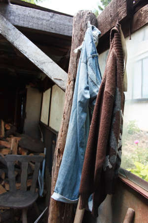 penthouse: Picture of old clothes abandoned in dirty wooden penthouse Stock Photo