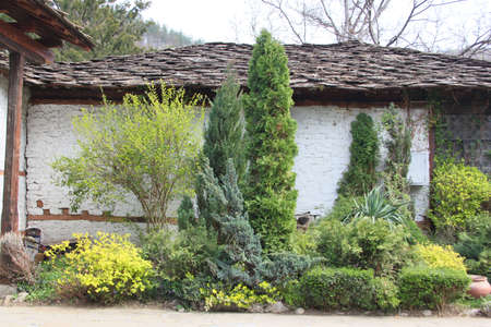 Garden decoration in front of old house photo