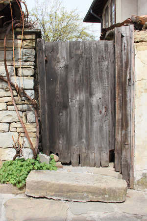 Picture of an old damaged wooden door photo