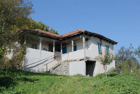 Old abandoned house in Bulgarian countryside photo