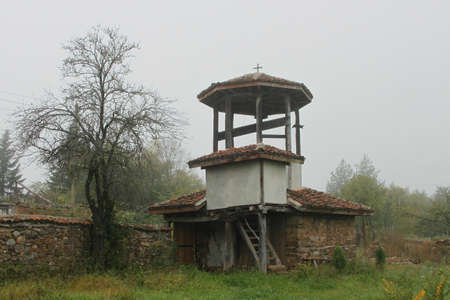 churchyard: Old steeple in country churchyard in the fog, Bulgarian countryside