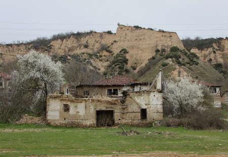 damaged house: Rural scene with old damaged house