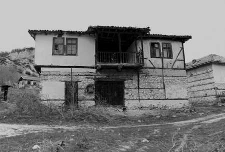 damaged house: Rural scene with old damaged house in black and white
